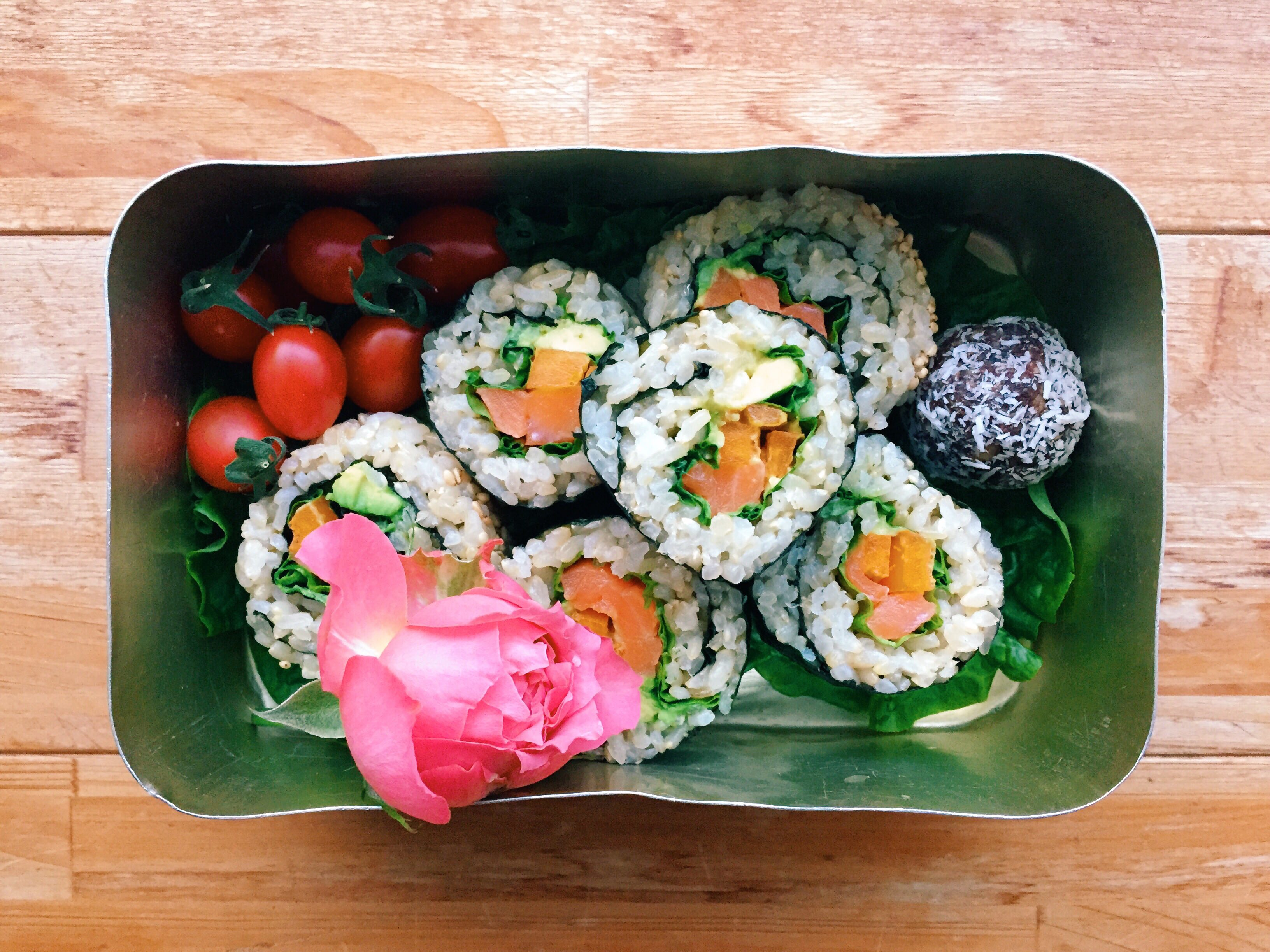 Beautifully presented Japanese bento with sushi