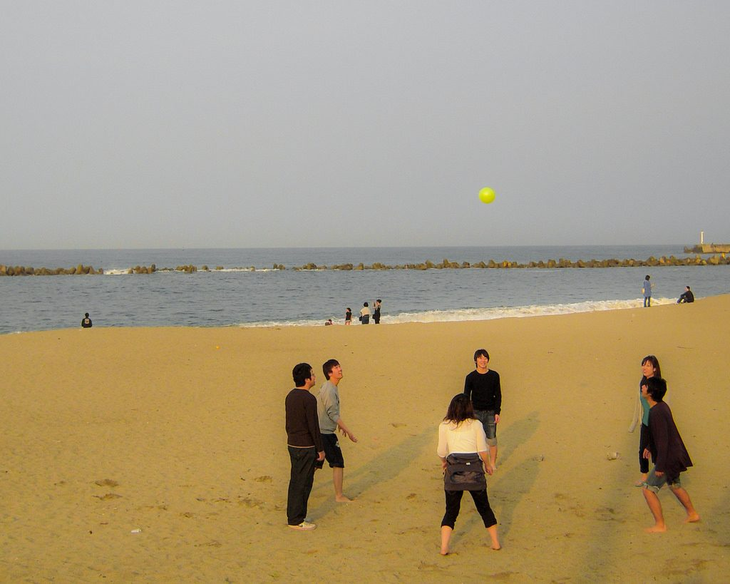 A group playing volleyball at Ishihama Beach in Ibaraki