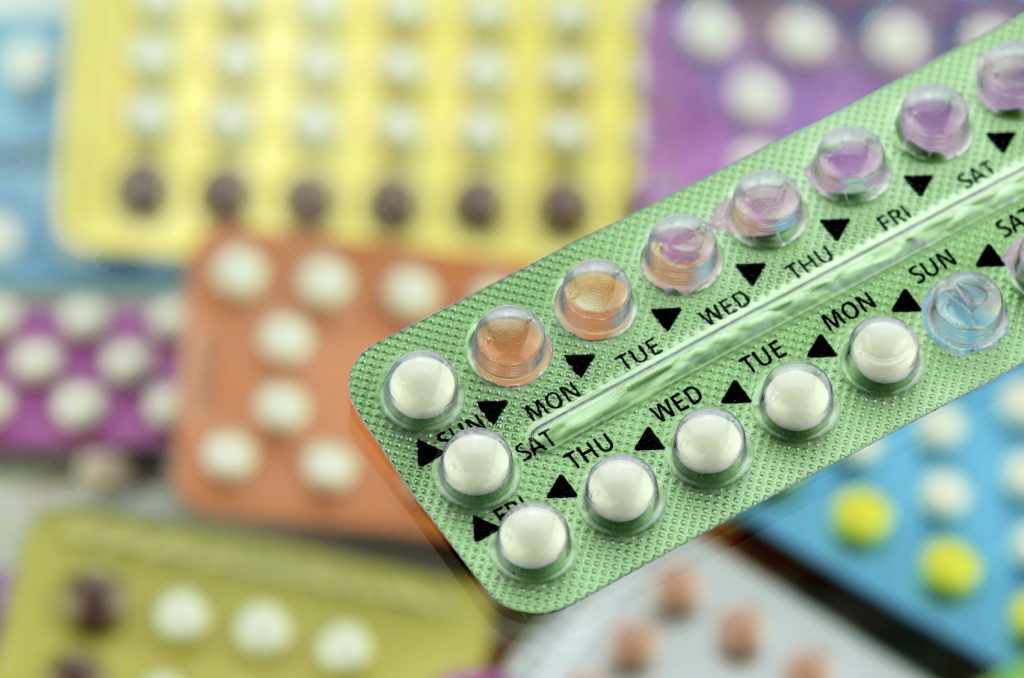Oral contraceptive pill on pharmacy counter.