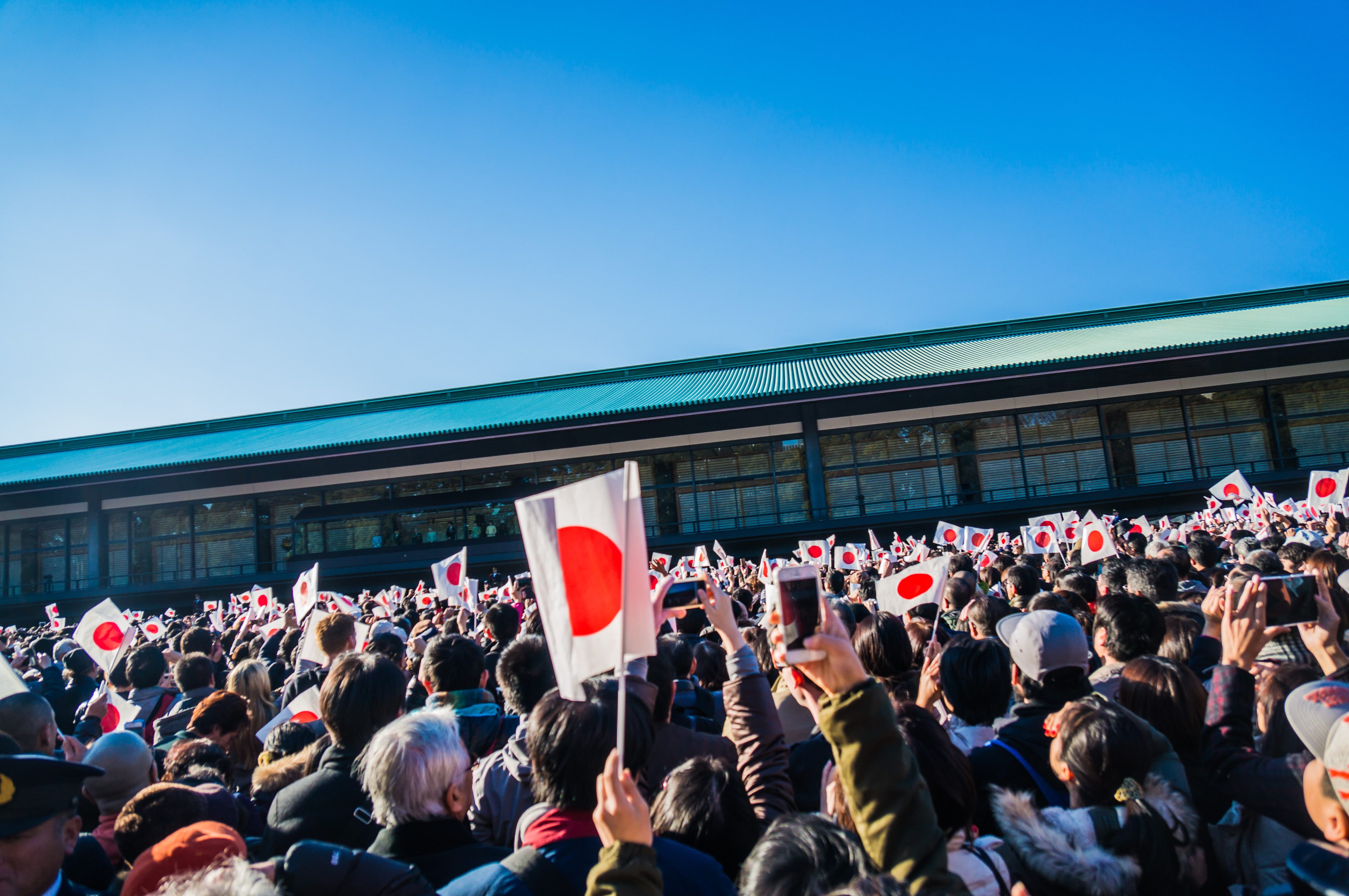 People holding Japanese flag in hand