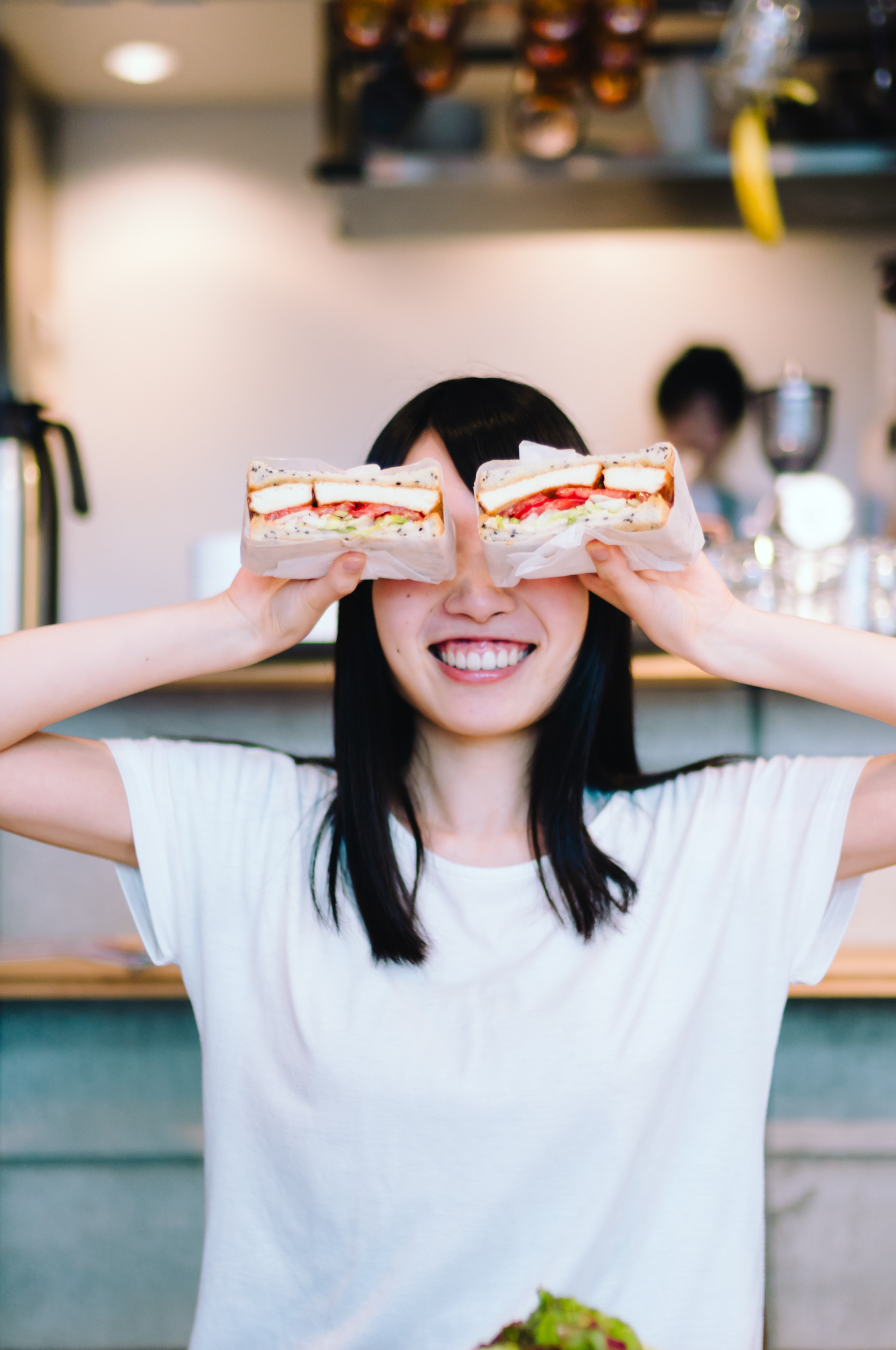 3 Health Tips I Learned In Japan That Helped Me Lose 18 Kilos - Losing Weight Japan - Woman holding two katsu sandwich