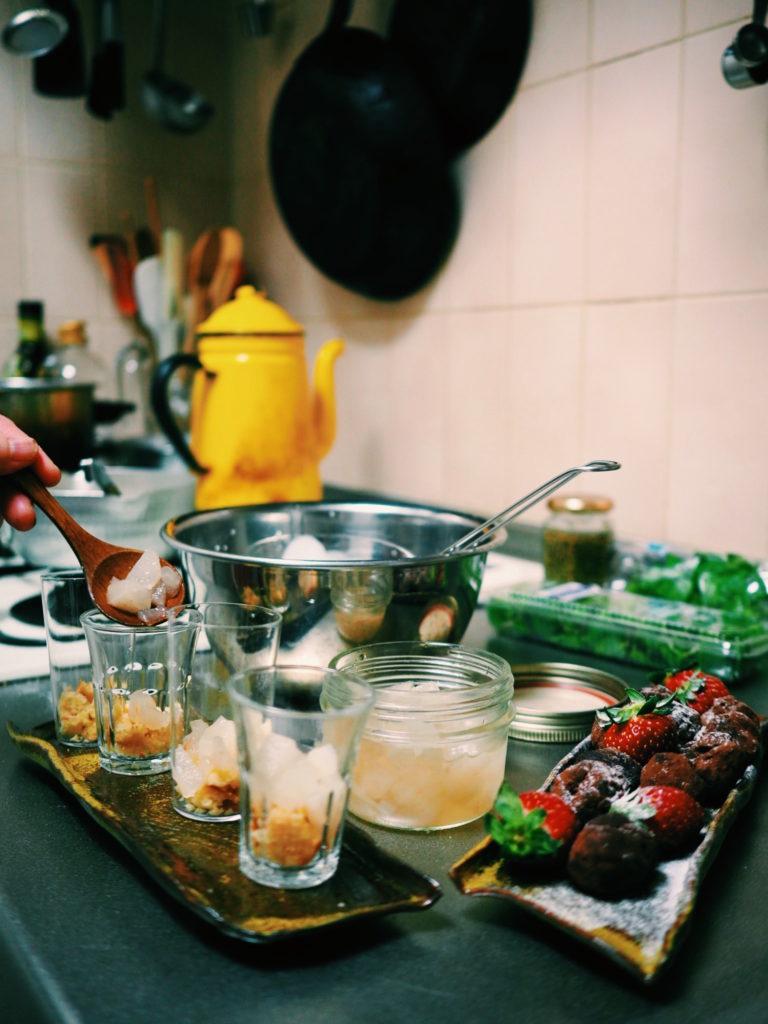 Aya-from-Tadaku-—-with-locals-putting-together-her-dessert.