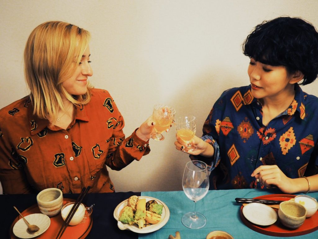 Stephanie-and-Yurino-Kira-cheersing-at-Tadaku-—-with-locals-dinner-party