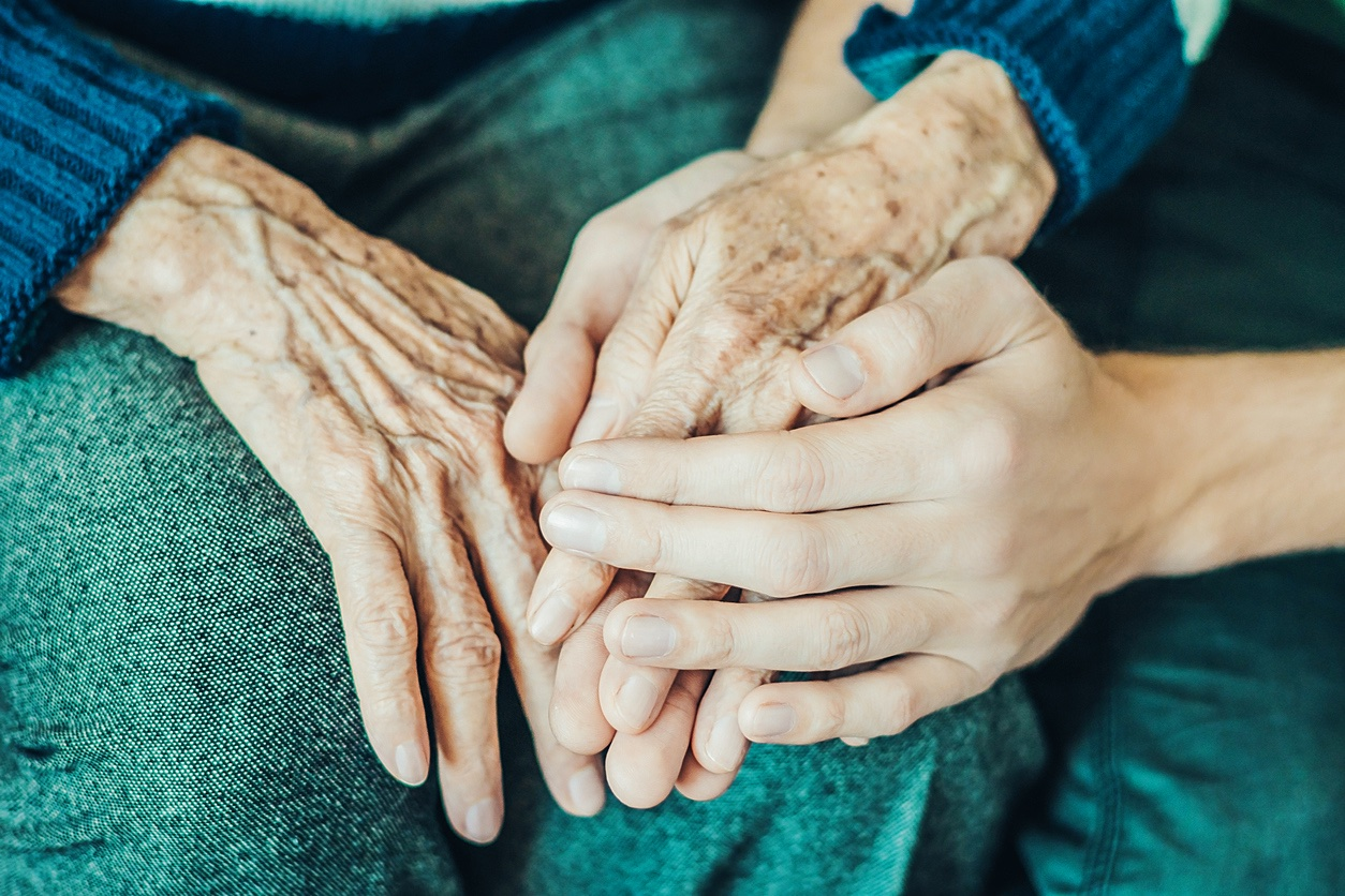 Hands of an old woman and a young man. Caring for the elderly ...