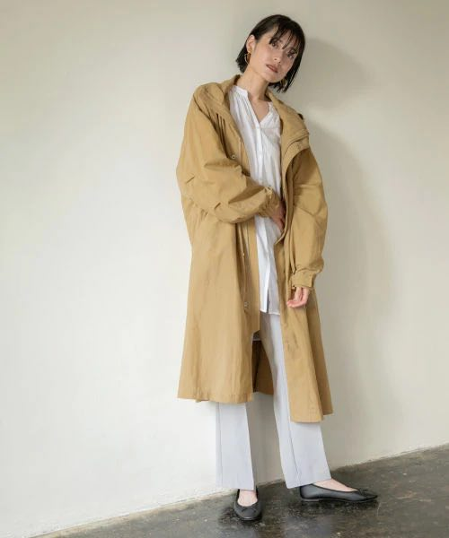 Top 5 Spring Fashion Trends In Tokyo 2020 4.Long Beige Trench Coat