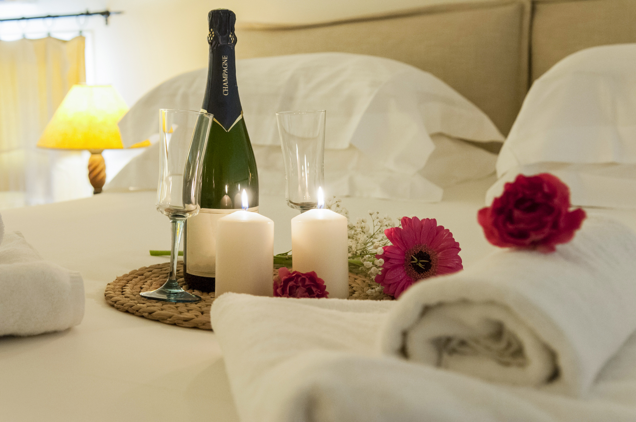 Japan's Love Hotels: 10 Hotels To Suit Every Taste - Champagne bottle, candles, flowers on a bed in a hotel room