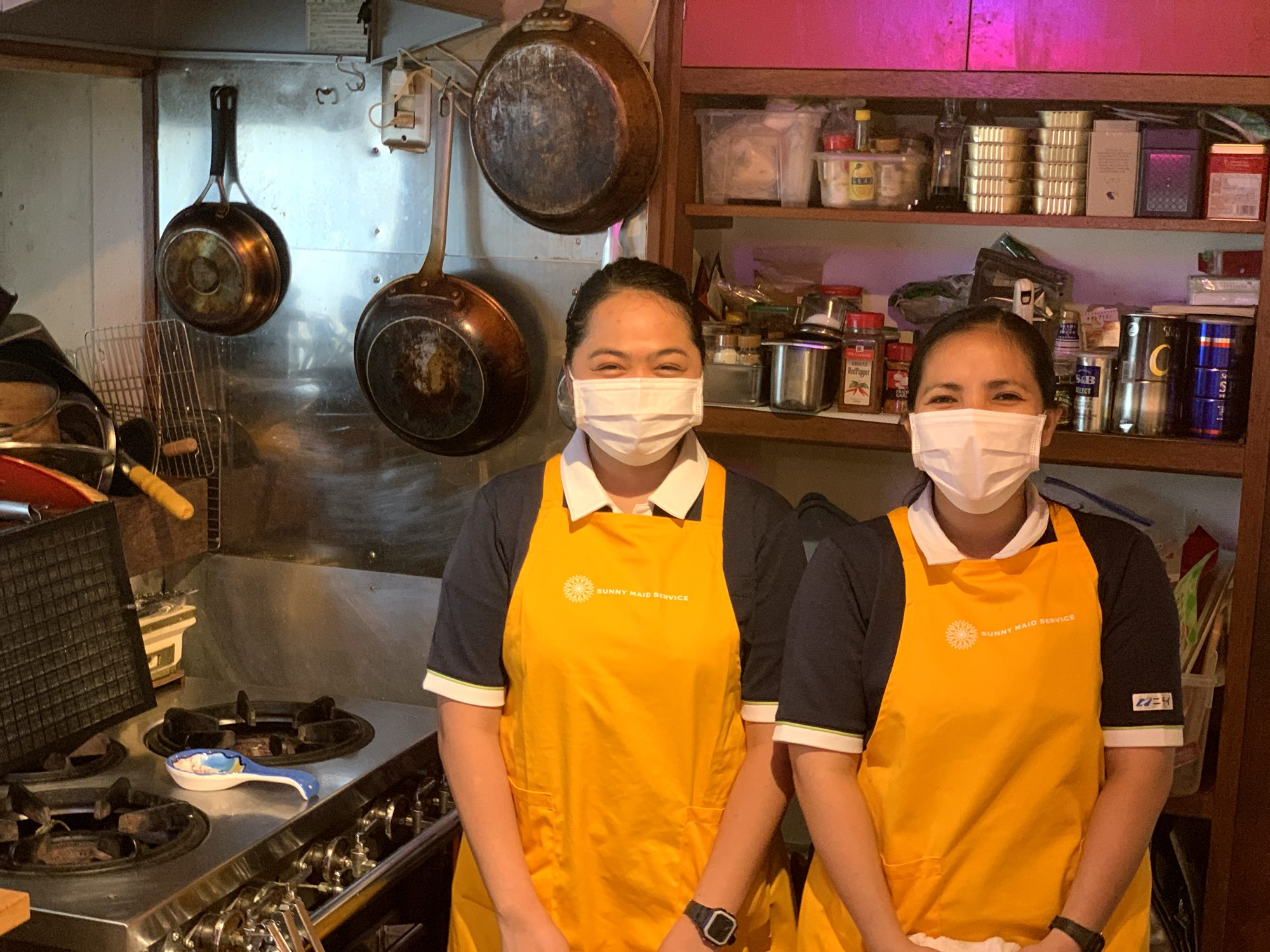 Sunny Maid Services maids smiling in the kitchen