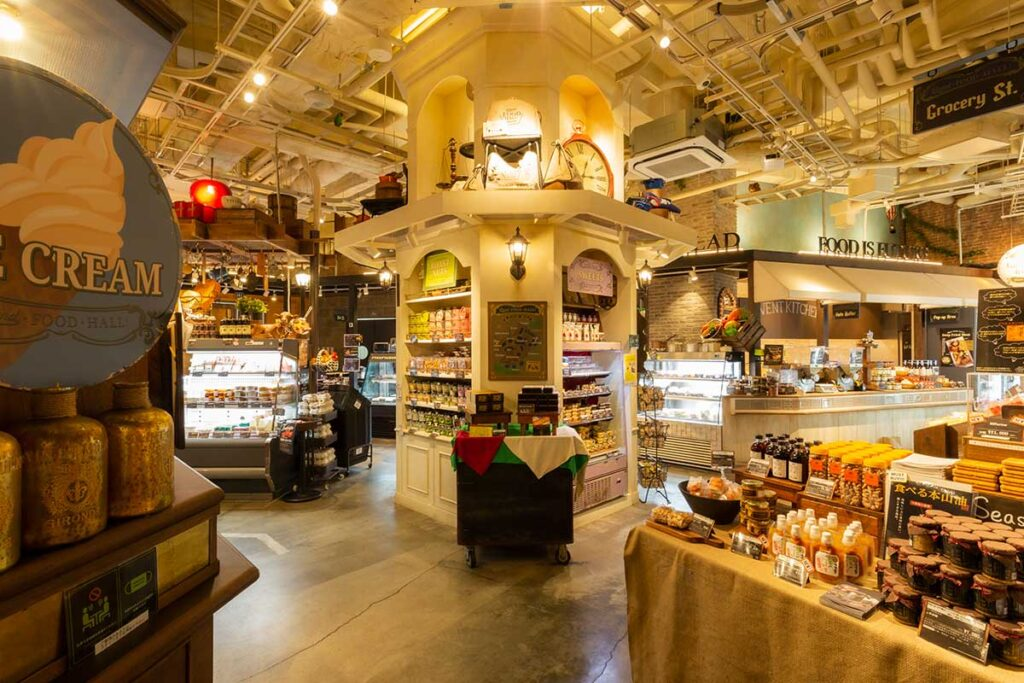 A deli section offers a variety of prepared foods, also a service to cook the ingredients you purchased on the spot.
